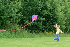 Child girl with kite