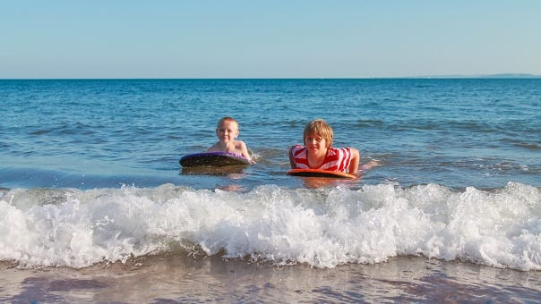 Toddler love to body board in the sea at Bude